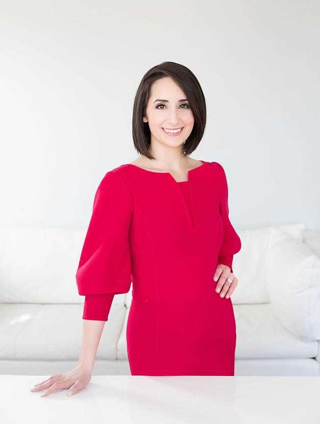 female attonery wearing red dress on a white background photographed with natural light