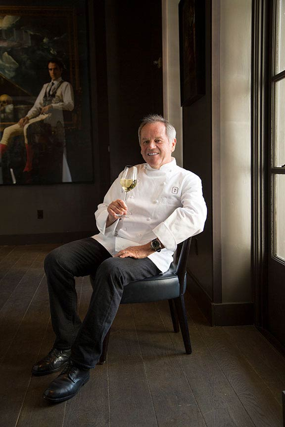 Portrait of Wolfgang Puck at his restaurant in Beverly Hills